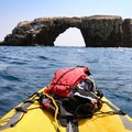 Exploring Arch Rock by kayak near Anacapa Island.- Best of Santa Barbara: Beaches, Camping, Parks, and Trails