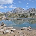 Island Lake reflections in Titcomb Basin.- Where to Watch August's Solar Eclipse