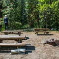 Picnic tables and a fire ring in Ida Creek Campground.- Oktoberfest in Leavenworth