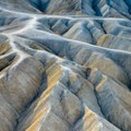 Eroded rock formations are the main attraction at Zabriskie Point.- A First Timer's Guide to Hiking in Death Valley National Park
