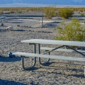 Picnic tables and pits at Stovepipe Wells Campground.- Camping in Death Valley National Park