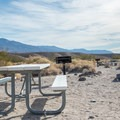 Picnic tables, barbecues, and views at Mesquite Spring Campground.- Camping in Death Valley National Park
