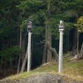 Totem poles along the coast of Johns Island.- San Juan Islands