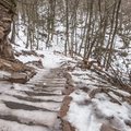 Snowy stairs leading to Kaaterskill Falls- The 8 Best Hikes in New York's Catskills