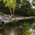 A rope swing over a pool beneath the Velo de Novia Waterfall.- 4 Tips To Take Your Costa Rica Adventures to the Next Level
