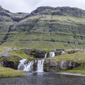 Kirkjufellsfoss from the middle of the river.- Dramatic Fjord Formations