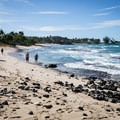 Rocks make Kukio Beach a little tricky for swimming, but there are still plenty of sandy places to enter the water.- Big Island's Best Beaches
