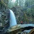 Drift Creek Falls with the suspension bridge in back.- Exploring Oregon's Coastal Waterfalls