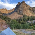 Backcountry campers enjoying the view of Sundial Peak (10,320 ft) while spending the weekend at Lake Blanche.- Guide to Camping Near Salt Lake City, Utah