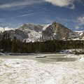 Mount Alice (13,310 ft) looms over a pond adjacent Lion Lake 1.- Winter Camping Essentials