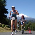 "Lisa Bentley. ""Ironman 70.3 Pucon. I had taken the lead in the race with the Volcano Villarica in the background. Funny story - I would meet the little girl leading me on the bike 10 years later when I was invited back to the race.""- Women In The Wild 2018: A Series of Celebrations + Conversations"