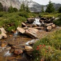 Altair Peak and a tumbling creek in Surprise Valley.- Best of the Sawtooths in Summer