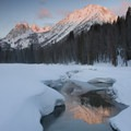 Sunrise relfected in an opening in Fishook Creek near the Fishhook Yurt.- Winter Retreat to Stanley, Idaho