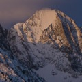 Sunrise on Horstman Peak near Fishhook Yurt. The narrow couloir in the left of the photo is the Sickle Couloir.- Winter Retreat to Stanley, Idaho