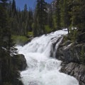 A waterfall during spring runoff at Redfish Inlet.- Best of the Sawtooths in Summer