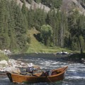 A driftboat guide contemplates the challenges of Sulphur Slide at low water on the Middle Fork of the Salmon River.- Seven of the West's Best Multi-Day Floats