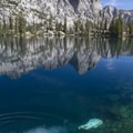 A backpacker cools off in the upper South Alpine Lake in Idaho's Sawtooth Mountains.- Adventure Outside of Your State