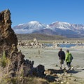 A couple enjoys a peaceful morning at the often crowed South Tufa Area.- California's 60 Best Day Hikes
