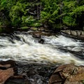 A visit to Monument Falls is a quick and easy adventure with amazing views of the icy river and surrounding mountains.- A Winter Adventure Weekend in Lake Placid, New York