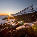 Sunset over the lunch counter as Mount Adams looms above and Mount St. Helens rests in the distance.- Mount Adams: South Climb