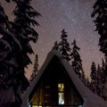 The Hemlock Butte cabin at night.- Glamping