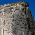 Hikers on Half Dome heading up the cables.- 15 Views that Will Inspire You to Hike the John Muir Trail