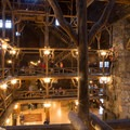 Lobby of Old Faithful Inn with its unique log and limb structure in Yellowstone.- Step Back in Time at These Amazing Historic Sites
