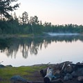 Dawn at a campsite on the North Kawishiwi River.- Mining Endangers Minnesota's Boundary Waters