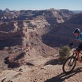 Riding along the rim on the Good Water Rim Trail.- A Complete Guide to the Best Mountain Biking in Moab, Utah