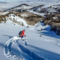 Skiing down a pristine looking No Name Bowl, Park City Ridgeline.- Great Backcountry Skiing Near Salt Lake City, Utah