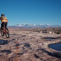 Moab Brand Trails, Circle O: Paint marking the trail on the slickrock.- A Complete Guide to the Best Mountain Biking in Moab, Utah