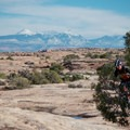 The La Sal Mountains loom in the distance on the MOAB Rockin' A.- Utah's Best Fall Adventures