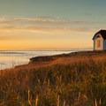 The sun sets over the Patos Island Lighthouse.- San Juan Islands