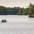 Morning canoe trip on Pawtuckaway Lake.- Best New Hampshire Towns for Family Adventure