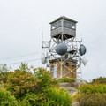 The Pitcher Mountain fire tower.- 15 Best Hikes for New Hampshire Fall Foliage