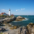 Looking north to the Portland Head Light from a viewpoint.- An Adventure Guide to the Maine Coast
