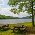 Putnam Pond: Picnic tables and grills along the shore.- 12 New York Lakes Perfect for Summer Adventure