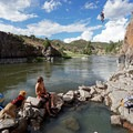 A cliff jumper jumps into the Colorado River from 45 feet above Radium Hot Springs.- Our Amazing River Basins