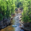 Nearing the end of the float tour through Ausable Chasm.- Breathtaking Cliffside Vistas