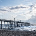 Sunrise is another great time to visit beaches like the one by Rodanthe Pier.- 7 Best Beaches of North Carolina's Outer Banks