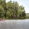 Kayakers on Rollins Pond.- Three Adirondack Paddling Adventures for your Bucket List