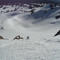 Looking down at a skier descending Ball Butte's eastern bowl.- Best Winter Adventure Destinations