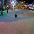 Sledding down under the lights in Front Street Park, Leavenworth.- 12 North American Mountain Towns Perfect for Winter Adventure