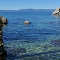 Blue waters of Lake Tahoe at Chimney Beach.- Memorial Day Trip Ideas