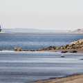 A distant lighthouse off of the coast of Sherwood Island State Park.- 15 Must-Visit New England State Parks