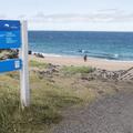A cautionary sign.- Víkingaaldarkuml í Skarðsvík