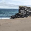 Large basalt formations along the beach.- Víkingaaldarkuml í Skarðsvík