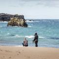 Visitors getting close to the water.- Víkingaaldarkuml í Skarðsvík
