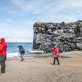 A large basalt wall at the northern end.- Víkingaaldarkuml í Skarðsvík
