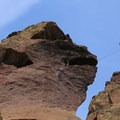 Slackliners and climbers on the Monkey Face. - Smith Rock, Misery Ridge Hiking Trail